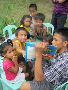 After a bowl of soup and fresh water to drink, the children are learning to read in the park where they live.